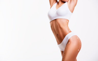 Sensual female body, cosmetic surgery and skin liposuction.