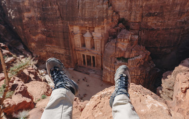 Wall Mural - Travelling in Petra, the rose city in Jordan. Traveler enjoying high angle view of ancient architecture and landmark of Middle East in Petra, Jordan