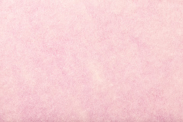 Light pink matt suede fabric closeup. Velvet texture of felt.