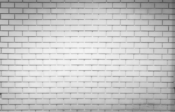 White brick wall texture background with space for text. White brick wallpaper. Home interior decoration. Architecture concept. Empty white wall for interior design background for store promotion.