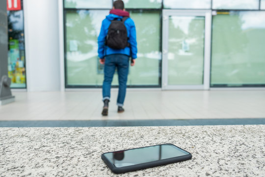 Person forgets smartphone on a bench in the street