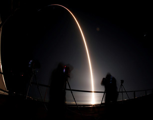 A SpaceX Falcon 9 rocket takes off loaded with a Dragon cargo craft during a resupply mission to the International Space Station from Cape Canaveral