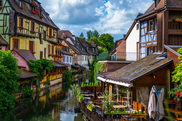 Spectacular colorful traditional french houses on the side of river Lauch in Petite Venise, Colmar, France, Europe. Old town on a sunny day after the rain.