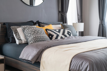 modern bedroom with set of pillows
