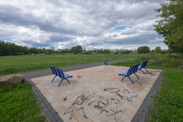 Seating on a bike path and green meadows on the outskirts of Berlin Marzahn-Hellersdorf