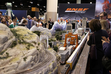 Shareholders check out a train display at the BNSF booth as they shop for discounted products at the annual Berkshire Hathaway shareholder meeting in Omaha
