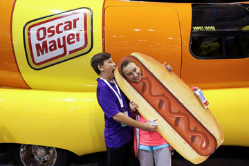 DJ O'Keefe and his sister Dallas pose for a photo with the Oscar Mayer Weiner Mobile at the annual Berkshire Hathaway shareholder meeting in Omaha