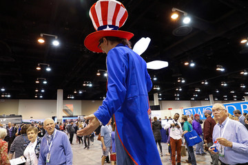 A performer on stilts encourages to elect Charlie Munger as Chairman in a mock campaign at the annual Berkshire Hathaway shareholder meeting in Omaha