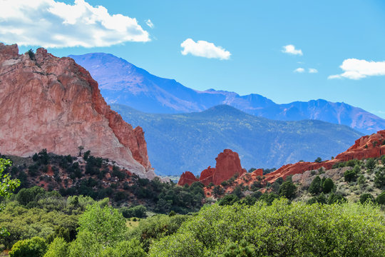 Red sandstone formations and bluffs near Colorado Springs with the distant blue Rocky Mountains in the background - selective focus