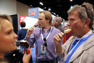 Shareholders eat treats from Dairy Queen as they shop for discounted products at the annual Berkshire Hathaway shareholder meeting in Omaha