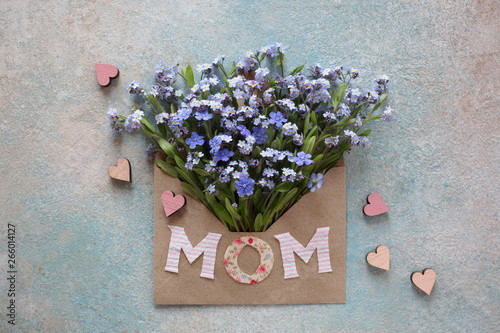 Background greeting with envelope and flowers forget-me-not, hearts for Mothers Day