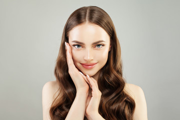 Perfect young woman with clear skin and long healthy hair. Natural beauty. Skincare and facial treatment concept