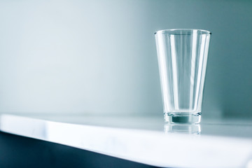 Clean empty glass on marble table