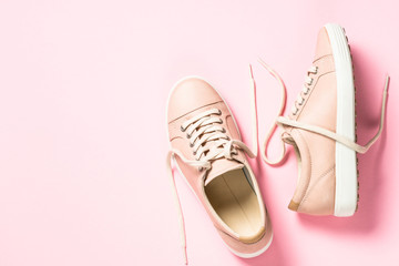 Pink shoes on pink top view. Wall mural