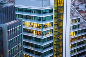 London, UK. Office windows of City of London buildings at night