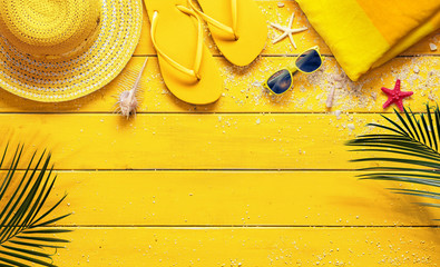 Yellow Summer Background With Beach Accessories And Palm Leaves Wall mural
