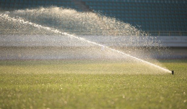 watering lawn in the sunrise stadium
