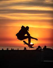 Skateboarder with Sunset Background