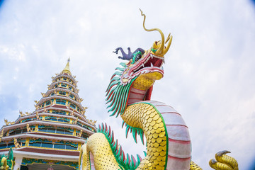 Wall Mural - Golden dragon architecture statue in buddhist temple