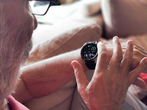 Old White Man Looking at his smart watch