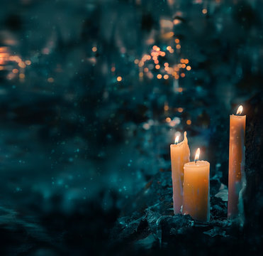 beautiful mysterious fairy scene. magic candles in forest. fabulous composition. Night forest and magic candles. Dark magic, witch ritual scene, Halloween background. Soft selective focus