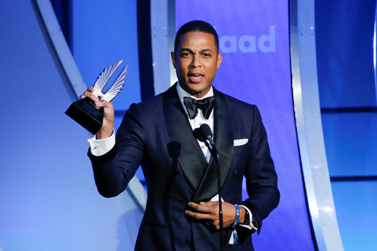 CNN news anchor Lemon holds up the outstanding TV journalism segment award during the 30th annual GLAAD awards ceremony in New York City, New York