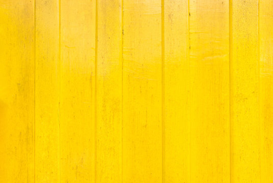 yellow paint wood wall texture background.vivid color for summer backdrop