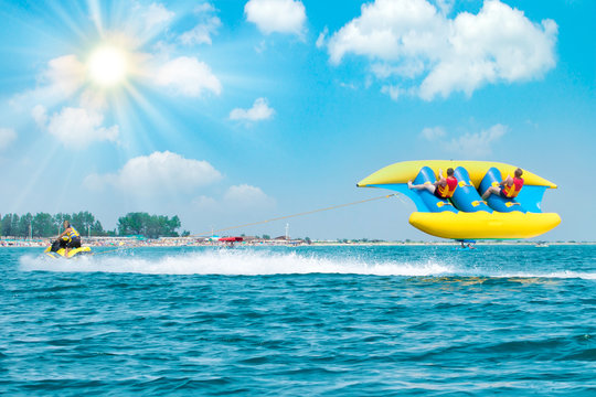 Young people on water attractions during summer vacations. Summer 2019. Welcome to active vacation