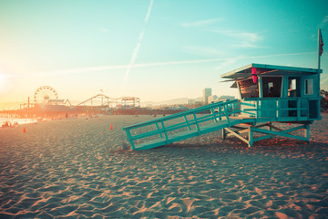 Iconic Santa Monica rescue cabin against famous amusement park in sunset
