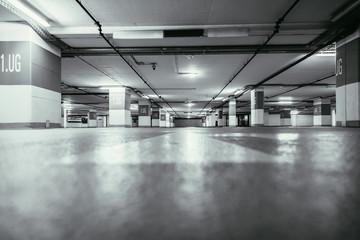 Foto op Aluminium Luchthaven Parking garage in the underground. Asphalt and empty parking lots.