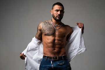 confidence charisma. muscular macho man with athletic body. sport and fitness, health. sexy abs of tattoo man. male fashion. brutal sportsman torso. steroids. sexy muscular body. muscular man