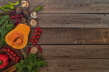 Vegetables on vintage wooden background. Autumn harvest. Organic food background. Farmers vegetable market. Seasonal fall vegetables. Rural still life from above with free text space. Toned image.