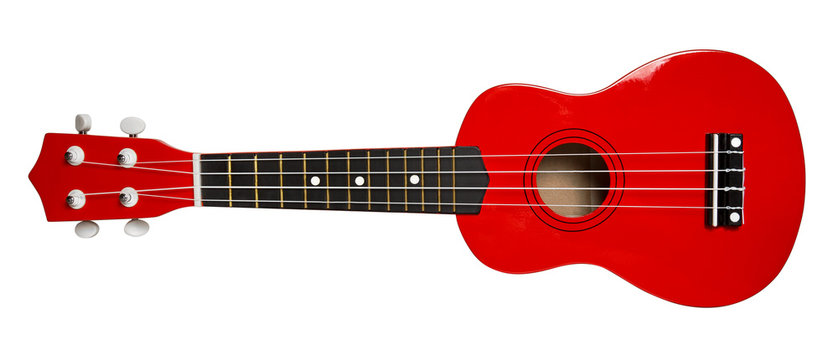 Red ukulele, isolated on white background