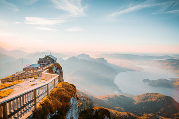 Wall Mural - Mountain summit cross on alpine peak at sunset