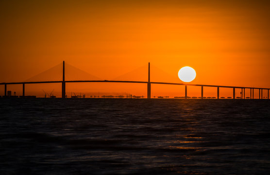 Dramatic colorful sunrise of the skyway Bridge on West Coast of Florida