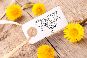 White Label With English Calligraphy Thank You. Dandelion Blossom On Wooden Rustic Background
