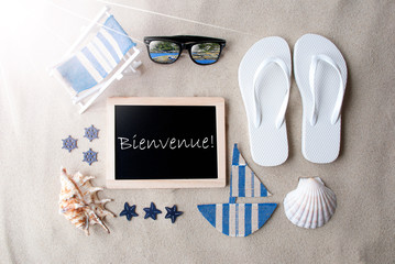 Flat Lay Of Chalkboard On Sandy Background. Sunny Summer Decoration As Holiday Greeting Card. Sand And Beach Environment. French Text Bienvenue Means Welcome