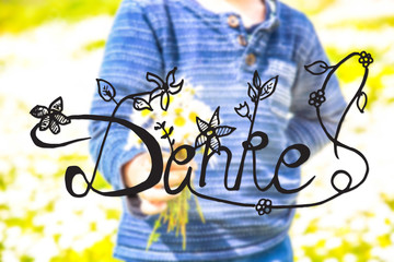 German Calligraphy Danke Means Thank You. Cute Little Kid Is Holding A Bouquet Of Daisy Flower. Sunny And Spring Flower Field.