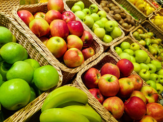 variety of fruits in baskets at grocery store