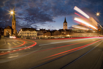 Traffic at night - Zurich skyline with tram and cars going by - long exposure