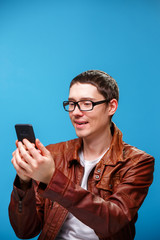 A man uses the phone and looks at the screen.