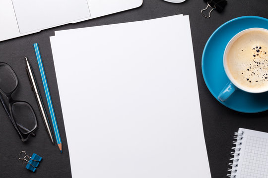 Office workplace table with blank paper page