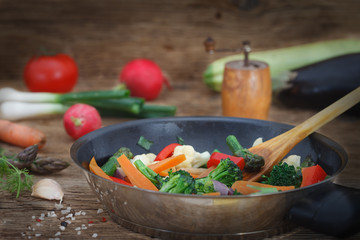 Mixed vegetables in the pan for healthy, low calories meal. Vegetarian food.