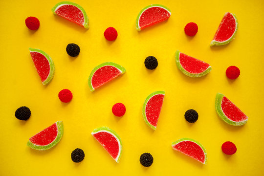 Fruit jelly segments in the form of watermelon on yellow