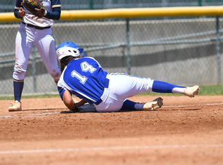 High School Softball Players making plays during a game