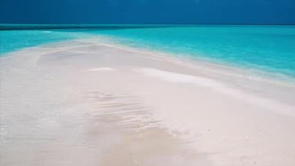 Wall Mural - Pristine sandy beach and blue calm sea. Maldives