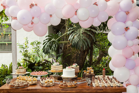 Table with sweets, desserts and cakes, decorated table for reception.