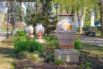 Alley with large garden vases