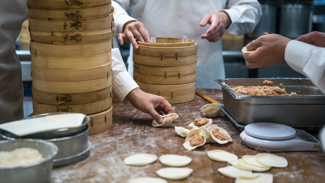 Taiwanese team chefs cooking traditional food. Asian chef making dumpling Taiwan