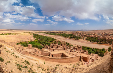 Wall Mural - Panoramic aerial view from top of Kasbah Ait Ben Haddou, a Berber fortress village near Ouarzazate in the Atlas Mountains of Morocco